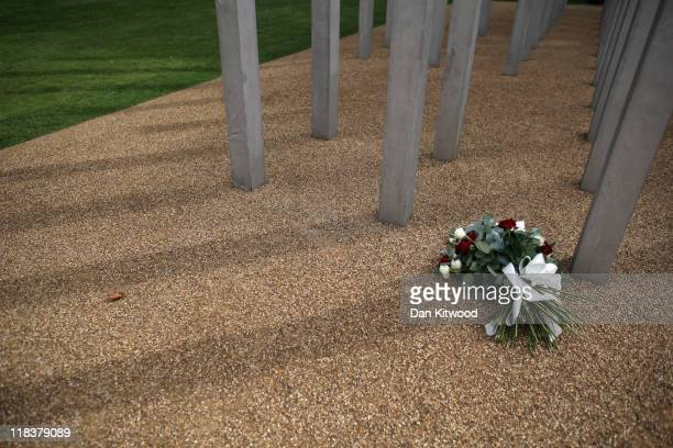 Flowers are laid at the memorial to the victims of the July 7 2005 London bombings in Hyde Park on July 7 2011 in London England Today marks the 6...