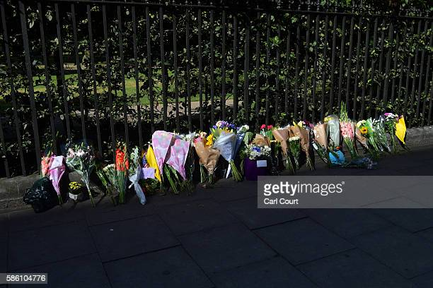Flowers are laid at the scene of a stabbing in which one woman was murdered on August 5 2016 in London England Darlene Horton a 64yearold US citizen...