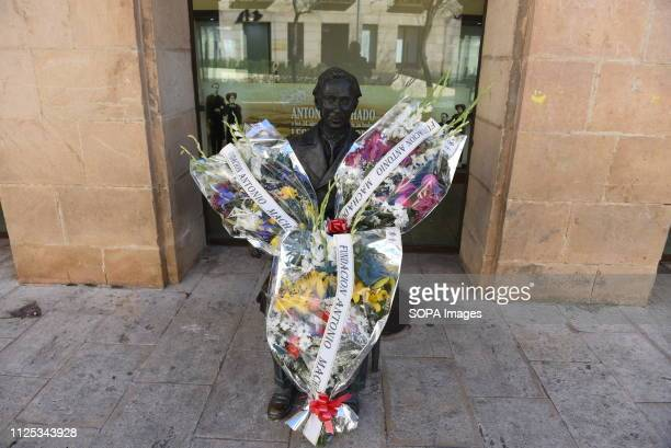 Flowers are laid before the statue of Spanish poet Antonio Machado in Soria north of Spain for the 80th anniversary of his death Antonio Machado is...