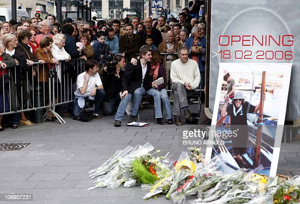 Flowers are laid in front of a portrait of Joe Van Holsbeeck near Brussels' Central Station 23 April 2006 A silent march in Brussels to protest...