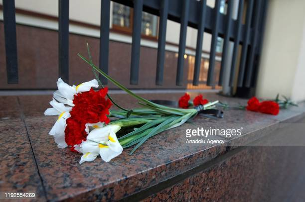 Flowers are laid in memory of victims of Ukrainian 737-800 plane that crashed in Iran, outside the embassy of Canada in Kiev, Ukraine, on 08 January...