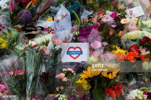 Flowers are laid on the south side of London Bridge close to Borough Market in tribute to the victims of the June 3rd attacks on June 5 2017 in...