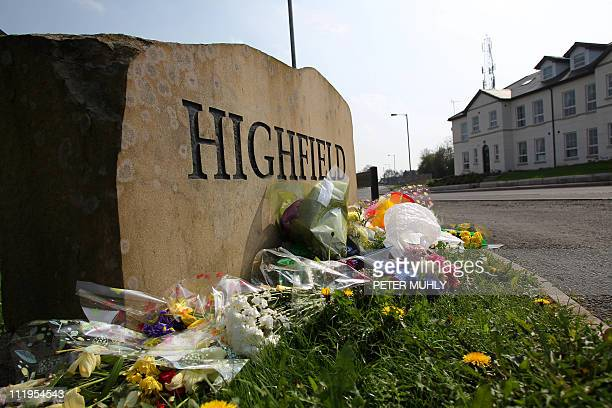 Flowers are layed across the street of Ronan Kerr's home as thousands of people attend a walk through the County Tyrone town of Omagh Northern...