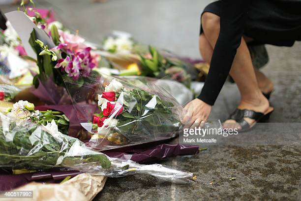 Flowers are left as a sign of respect at Martin Place on December 16 2014 in Sydney Australia The siege in Sydney's Lindt Cafe in Martin Place is...
