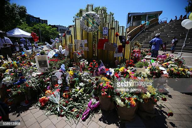Flowers are left at a memorial following the death of boxing legend Muhammad Ali outside the Muhammad Ali Center, in Louisville, Kentucky on June 8,...
