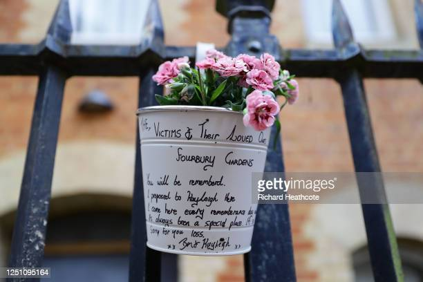 Flowers are left at an entrance to Forbury Gardens for the victims of the stabbing attack on June 21 2020 in Reading England A lone attacker targeted...