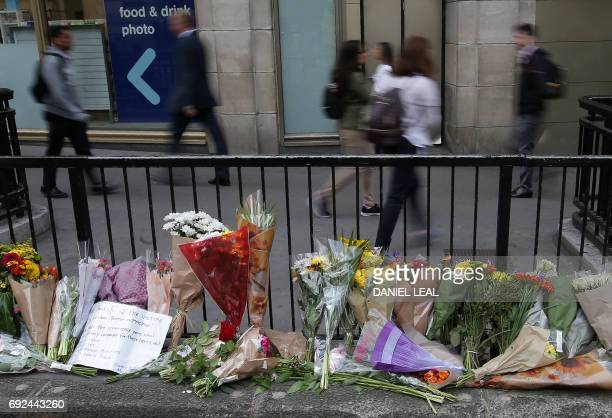 Flowers are left at Monument station near London Bridge in London on June 5 2017 following the June 3 terror attack British police on Monday made...