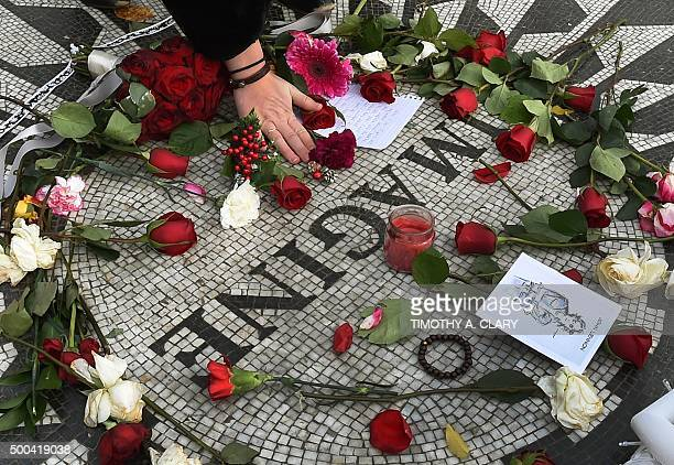 Flowers are left at the mosaic named for the John Lennon's song Imagine December 8 2015 at Strawberry Fields the Central Park garden dedicated in his...