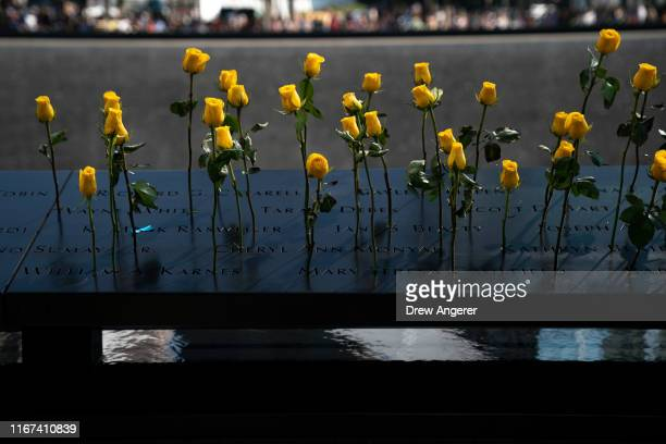 Flowers are left at the National September 11 Memorial on the 18th anniversary of the 9/11 attacks September 11 2019 in New York City Throughout the...