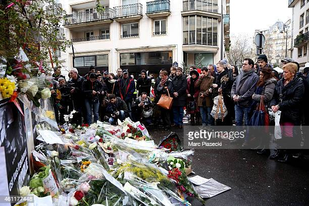 Flowers are left close to the Charlie Hebdo offices on a day of mourning following a terrorist attack at the satirical newspaper building on January...