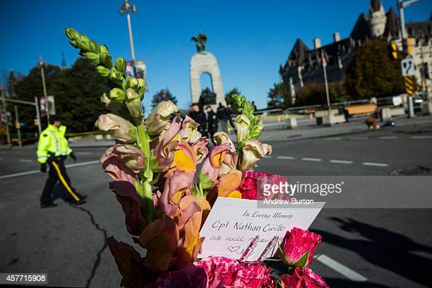 Flowers are left in memorial for Cpl Nathan Cirillo of the Canadian Army Reserves who was killed yesterday while standing guard in front of the...