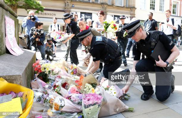 Flowers are left in St Ann's Square Manchester the day after a suicide bomber killed 22 people including children as an explosion tore through fans...