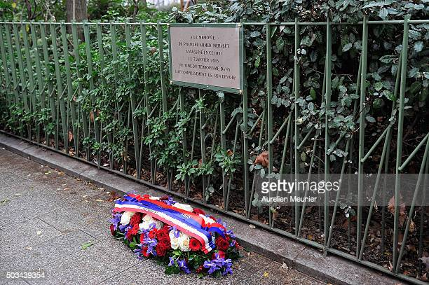 Flowers are left near the memorial stone in tribute to the police Officer Ahmed Merabet stone in next to former Charlie Hebdo office on January 5...