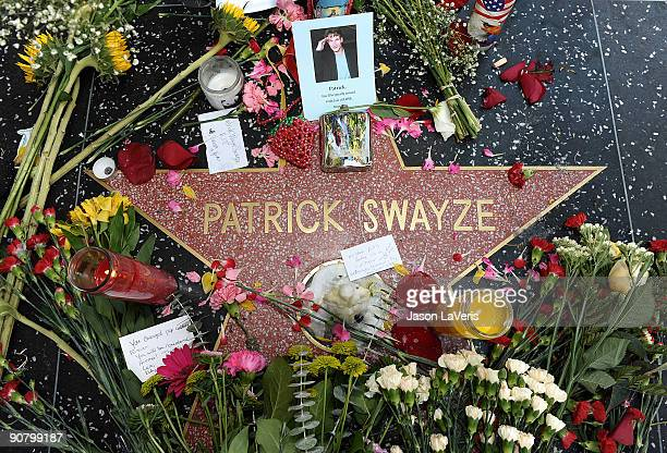 Flowers are left on Patrick Swayze's star on the Hollywood Walk of Fame after his death on September 15 2009 in Hollywood California