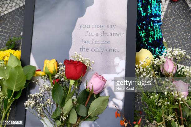 "Flowers are left on the ""Imagine"" memorial in honor of John Lennon on the 40th anniversary of his death at Strawberry Fields in Central Park on..."