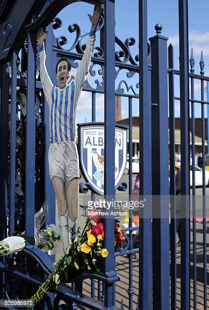 Flowers are left on the Jeff Astle gates on Jeff Astle Day celebrating the former WBA legend who made his debut against Leicester City