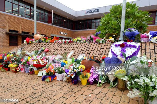 Flowers are left outside the Henderson Police Station in memory of police officer Matthew Hunt on June 21, 2020 in Auckland, New Zealand. Two...