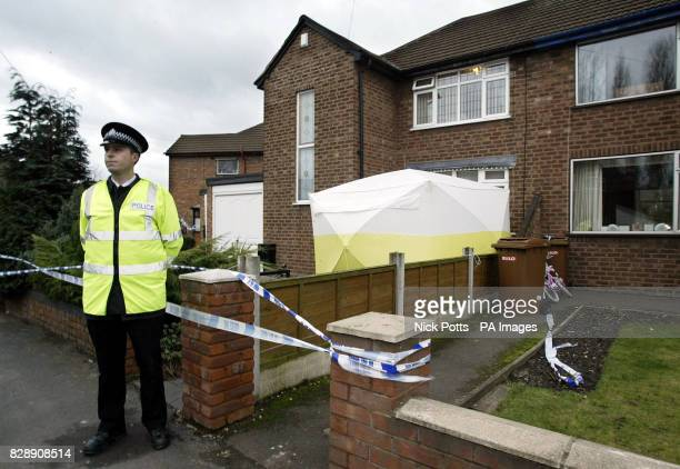 Flowers are left outside the house in Willenhall Staffordshire where a murder inquiry has been launched after the bodies of a woman and two young...