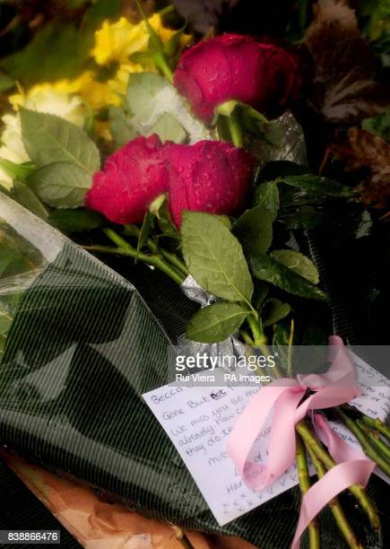 Flowers are left outside woodland near the village of Aberkenfig Bridgend south Wales where the body of Rebecca Aylward was found on Sunday
