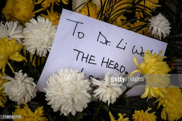 Flowers are left to pay tribute to Dr Li Wenliang at Li's hospital on February 072020 in WuhanHubei provinceChina Dr Li regarded a whistleblower on...