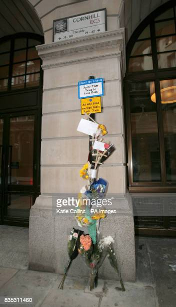 Flowers are near the Bank of England in the City of London close to where Ian Tomlinson lost his life after collapsing during the G20 protests