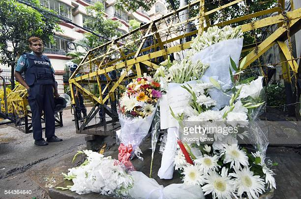 Flowers are offered on July 3 near an upscale restaurant in Dhaka that was the site of a terrorist attack launched July 1 in which 20 people...