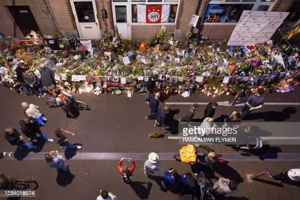 Flowers are palced at the spot where where Dutch journalist Peter R. De Vries was shot in the Lange Leidsedwarsstraat, in Amsterdam on July 16, 2021....