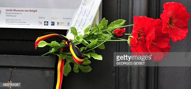 Flowers are pictured at a makeshift memorial at the entrance of the Jewish Museum in Brussels, on May 25 where a deadly shooting took place the day...