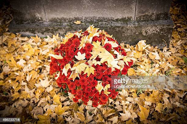 Flowers are pictured at the Pere Lachaise cemetery on November 1 2015 in Paris during the AllSaints Day AFP PHOTO / LIONEL BONAVENTURE