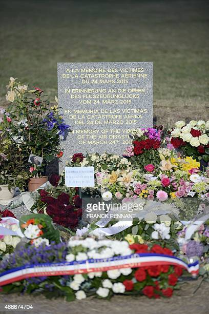 Flowers are pictured in the village of Le Vernet southeastern France on April 5 2015 near a stela commemorating the victims of the March 24...