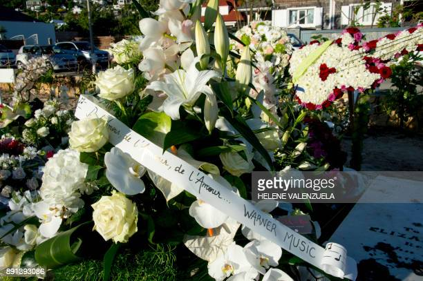 Flowers are pictured on the tomb of late French music icon Johnny Hallyday on the French Caribbean island of SaintBarthelemy on December 12 a day...