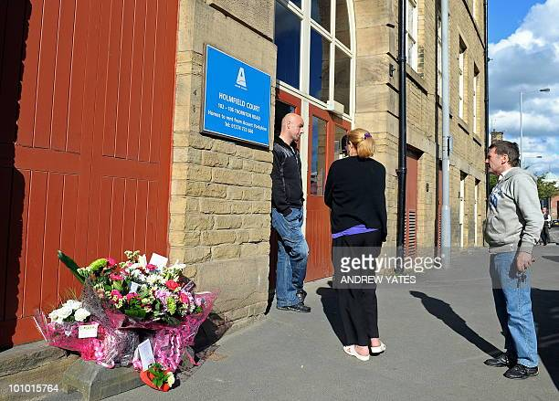 Flowers are pictured outside Holmfield Court flats following the arrest of a man in connection with the murders of three prostitutes in Bradford West...