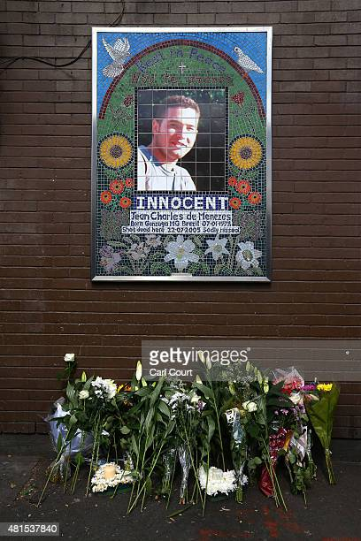 Flowers are pictured under a mosaic of Brazilian national Jean Charles de Menezes during a memorial to mark the 10th anniversary of his death on July...