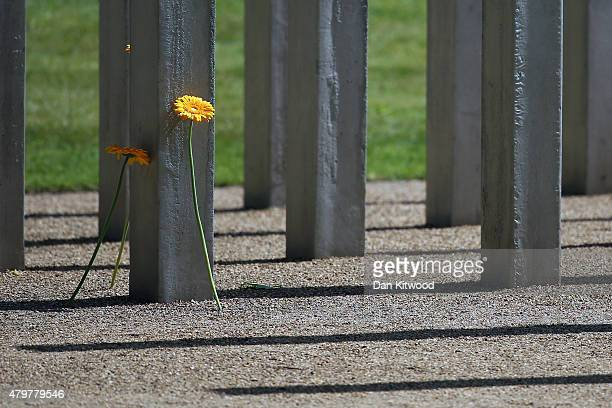 Flowers are place at the memorial to the victims of the July 7 2005 London bombings in Hyde Park on July 7 2015 in London England Today is the tenth...