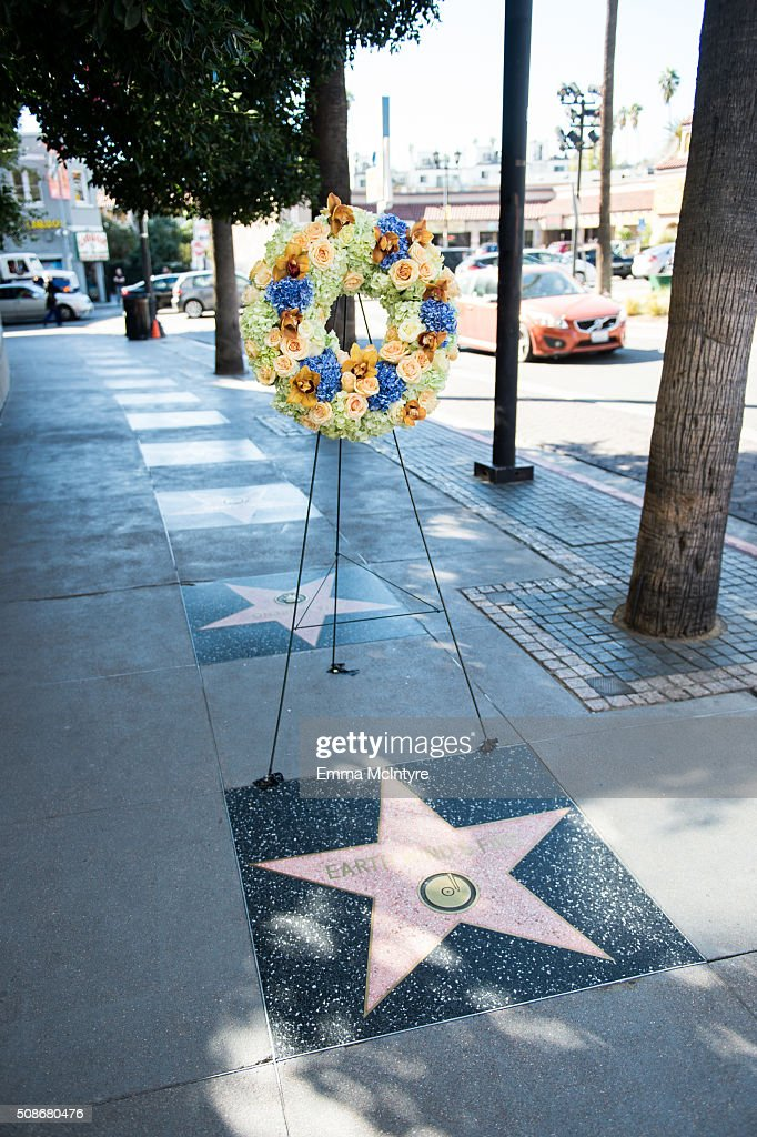 Flowers are placed as a memorial to musician Maurice White on his Hollywood Walk of Fame star on February 5, 2016 in Hollywood, California.