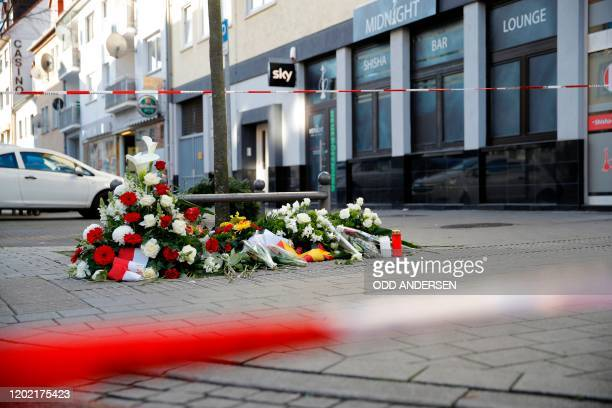 Flowers are placed at a makeshift memorial for the victims of the Hanau shooting in front of a shisha bar in Hanau near Frankfurt am Main western...