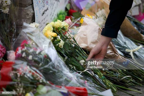 Flowers are placed at a memorial for victims of the mass killing on Yonge Street at Finch Avenue on April 24 2018 in Toronto Canada A suspect...