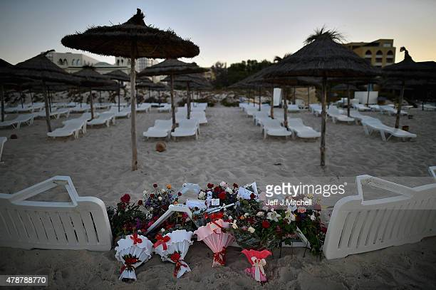 Flowers are placed at the beach next to the Imperial Marhaba Hotel where 38 people were killed yesterday in a terrorist attack on June 27 2015 in...