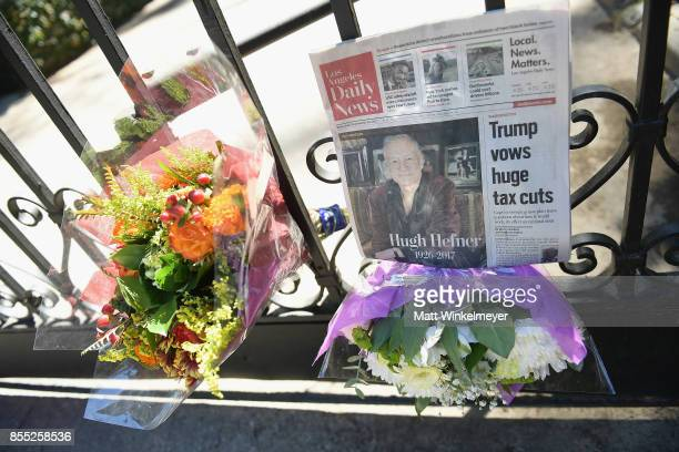 Flowers are placed at the gate of the Playboy Mansion in remembrance of Hugh Hefner on September 28 2017 in Los Angeles California Hefner died...