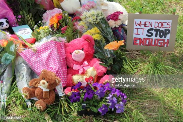 Flowers are placed during a memorial ceremony at the location where a family of five was hit by a driver in London, Ontario, Canada on June 08, 2021....