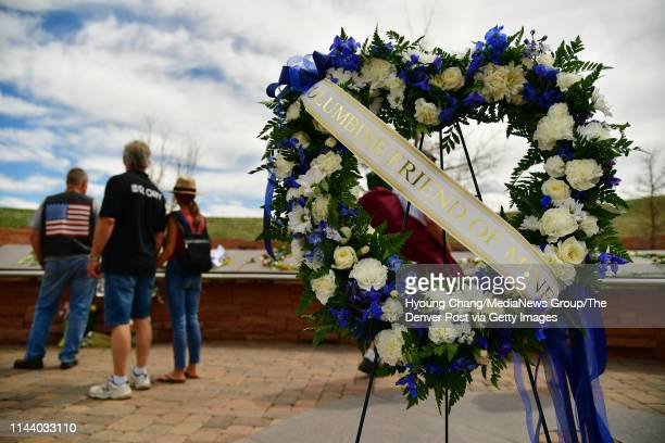 Flowers are placed for Columbine 20 years that honor and remember those who were impacted by the events on April 20 1999 at the Columbine Memorial in...