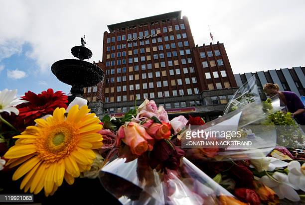 Flowers are placed in front of the damaged Labour Party's headquarters from the July 22 bomb attack in Oslo on July 27 2011 Norway's flower sellers...