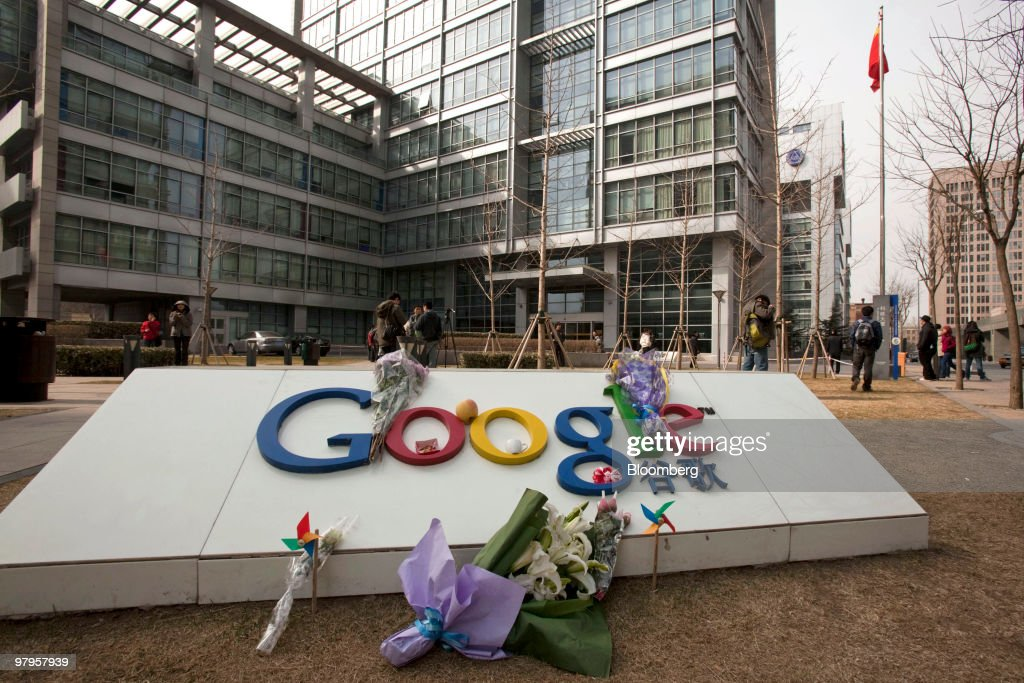 Flowers are placed on a sign outside the Google Inc. office in Beijing, China, on Tuesday, March 23, 2010. Google Inc., following through on a pledge to stop censoring search results in China, began serving mainland Chinese users via its unfiltered Hong Kong site, a move that could prompt the government to block the service. Photographer: Adam Dean/Bloomberg via Getty Images