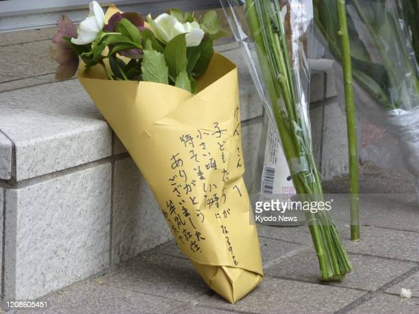 Flowers are placed on March 30 in front of the home of veteran Japanese comedian Ken Shimura who died of pneumonia caused by the novel coronavirus...