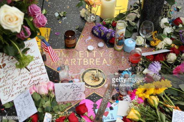 Flowers are placed on musician Tom Petty's star on The Hollywood Walk of Fame on October 3 2017 in Hollywood California Petty died on October 2 2017...