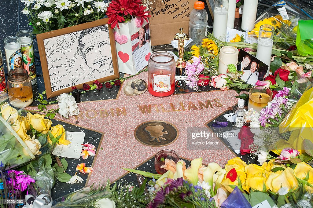 Flowers are placed on Robin Williams Hollywood Walk of Fame star on August 12, 2014 in Los Angeles, California.