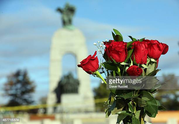OTTAWA ON OCTOBER 23 Flowers are placed on the barrier near the War Memorial in the aftermath of a shooting in Ottawa where a soldier murdered at the...