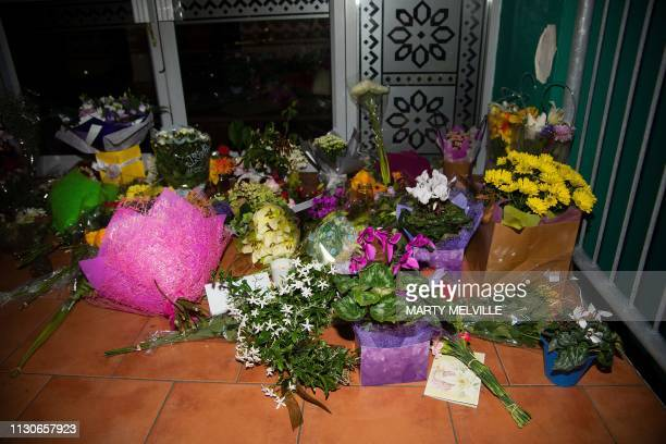 Flowers are placed on the front steps of the Wellington Masjid mosque in Kilbirnie in Wellington on March 15 after a shooting incident at two mosques...