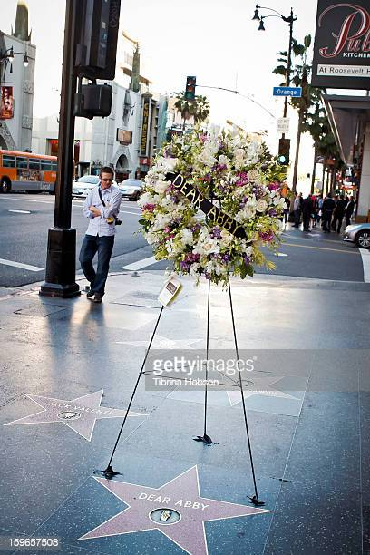 Flowers are placed on the Hollywood Walk of Fame Star in remembrance of 'Dear Abby' writer Pauline Phillips on January 17, 2013 in Los Angeles,...