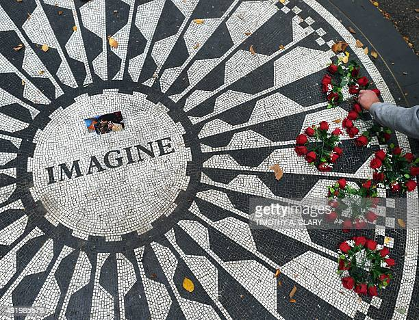 Flowers are placed on the Imagine mosaic plaque in the Strawberry Fields section of Central Park in New York an area dedicated to the memory of John...